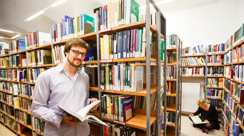 phd-in-economics-student-in-the-library